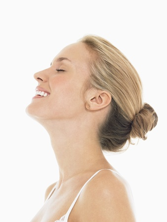 woman profile: Young Blond Woman Laughing LANG_EVOIMAGES
