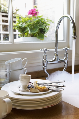 Stack of Dirty Dishes Next to Sink Stock Photo - 18885838