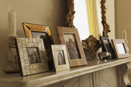 Fireplace Mantel With Framed Pictures Stock Photo - 18886173