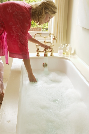 beforehand: Woman Preparing Bubble Bath
