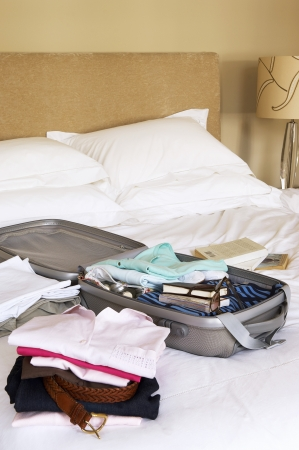 Packed Suitcase on Bed Stock Photo - 18886247