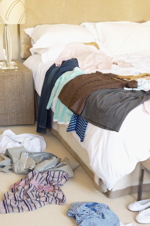 messy clothes: Clothes on Floor and Bed