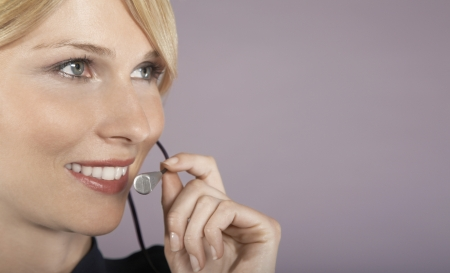 helpfulness: Businesswoman Wearing Telephone Headset LANG_EVOIMAGES