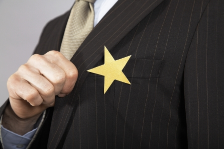 achieved: Businessman with Gold Star on Suit