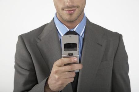 telephoning: Businessman Telephoning LANG_EVOIMAGES