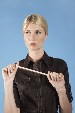 Businesswoman Stretching Rubber Band