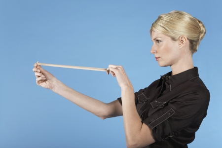 Businesswoman Shooting Rubber Band