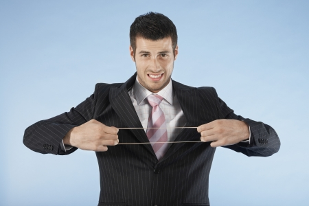 Businessman Stretching Rubber Band Stock Photo