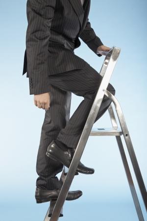 scaling ladder: Businessman Ascending Corporate Ladder