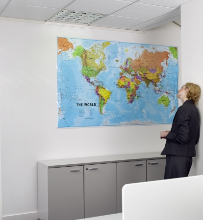 opting: Businesswoman Looking at World Map
