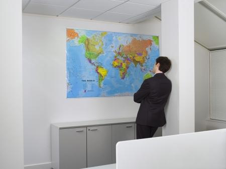 opting: Businessman Looking at World Map