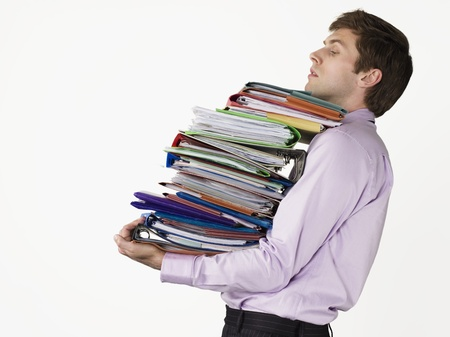 large group of items: Businessman Carrying Too Many Binders LANG_EVOIMAGES