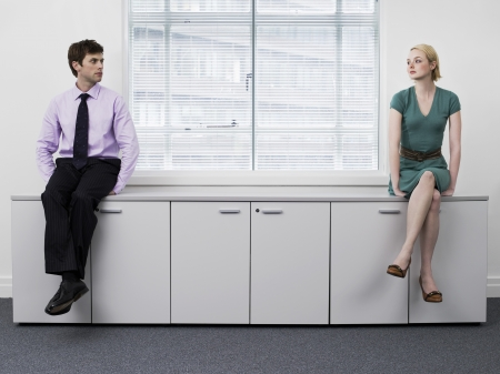 Businesspeople Sitting on Cabinets