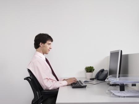 hooked up: Businessman Working at Desk