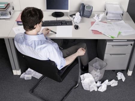 ennui: Businessman Brainstorming at Desk