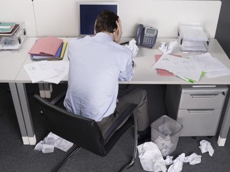 pressured: Overworked Businessman at Desk