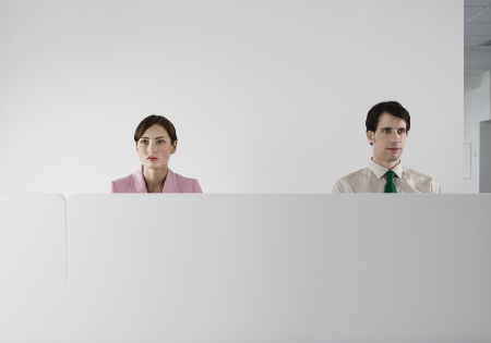mundane: Office Workers Behind Cubicle Wall LANG_EVOIMAGES