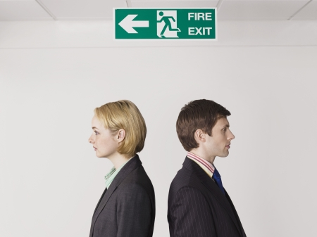 exit sign: Businesspeople Under Exit Sign LANG_EVOIMAGES
