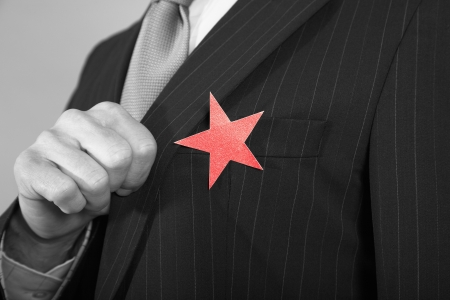 cropped out: Businessman with Red Star on Suit LANG_EVOIMAGES