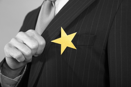 cropped out: Businessmen with Golden Star on Suit LANG_EVOIMAGES