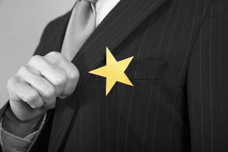 succeeding: Businessmen with Golden Star on Suit LANG_EVOIMAGES