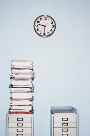 pressured: Stack of Documents on File Cabinet LANG_EVOIMAGES