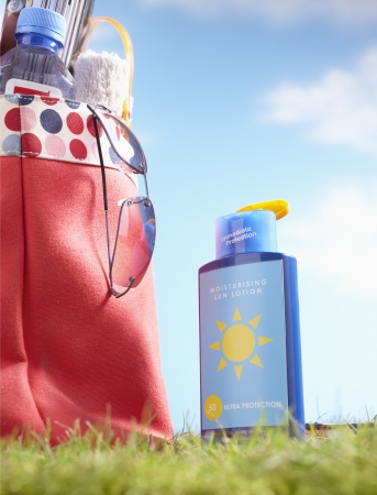 beforehand: Suntan Lotion and Bag With Beach Items