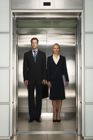 Businesspeople Side by Side in Elevator