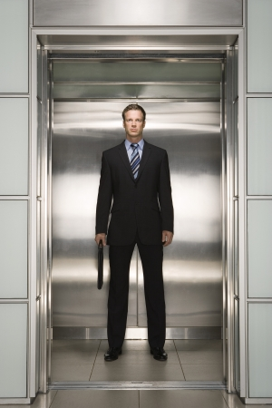 elevator: Businessman in Elevator LANG_EVOIMAGES