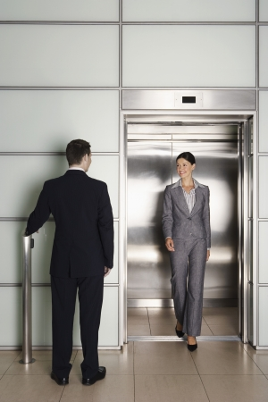 late thirties: Businesspeople Using Office Elevator LANG_EVOIMAGES