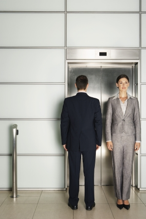 duality: Businesspeople In and Out of Office Elevator LANG_EVOIMAGES