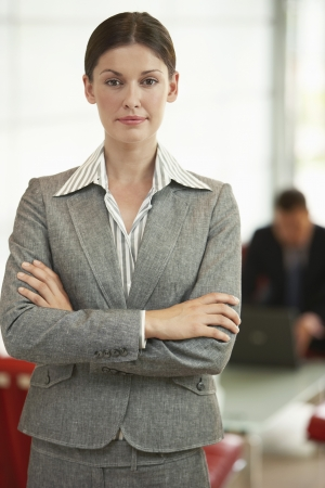 one person with others: Confident Businesswoman