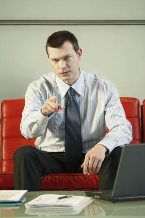 reprimanding: Stern Businessman Pointing
