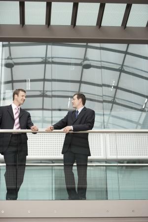 cooperating: Two Businessmen Talking