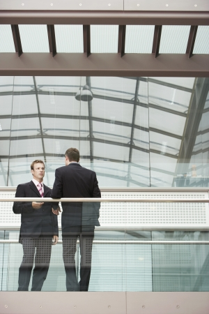 conversational: Two Businessmen Talking