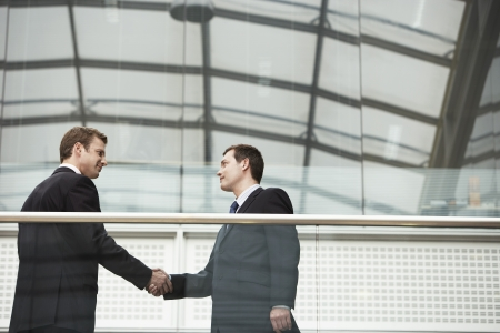 teammate: Two Businessmen Shaking Hands