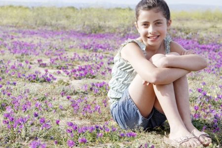 preadolescence: Little Girl in a Field of Flowers LANG_EVOIMAGES