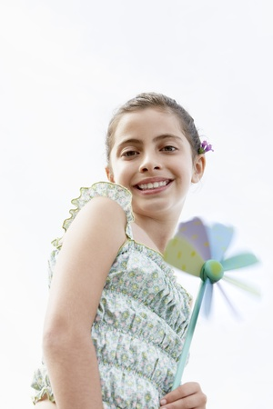 preadolescence: Little Girl Holding a Pinwheel LANG_EVOIMAGES