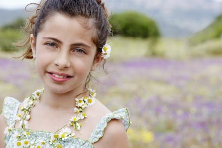 preadolescence: Little Girl With Flowers in her Hair