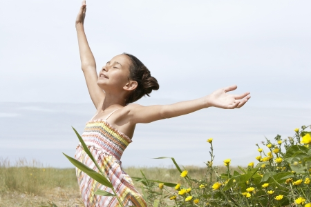 preadolescence: Little Girl Enjoying the Sunshine LANG_EVOIMAGES