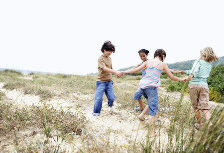Children Vacationing on the Beach Stock Photo