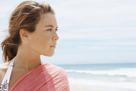 vacationing: Young Woman at Beach