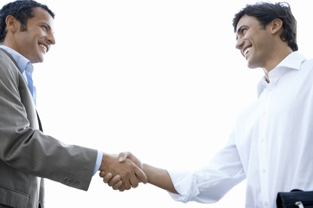 two persons only: Businessmen Shaking Hands LANG_EVOIMAGES