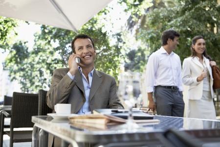 hooked up: Businessman at Sidewalk Cafe