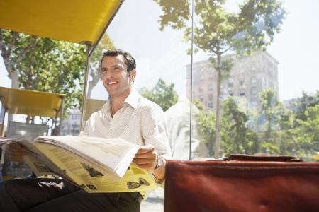 spaniards: Commuter Reading Newspaper
