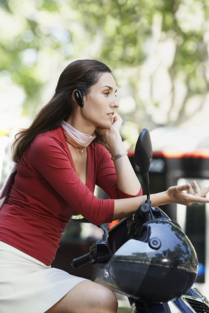 headset: Businesswoman Using Cell Phone on Moped