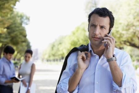 hooked up: Businessman on Cell Phone LANG_EVOIMAGES