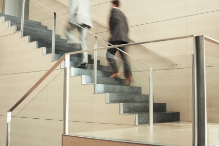 businesspersons: Businessmen Climbing Stairway