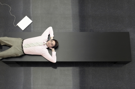microcomputer: Businessman Lying down on Public Bench