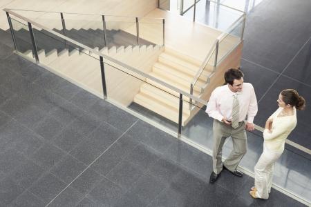 conversational: Businesspeople Conversing on Mezzanine